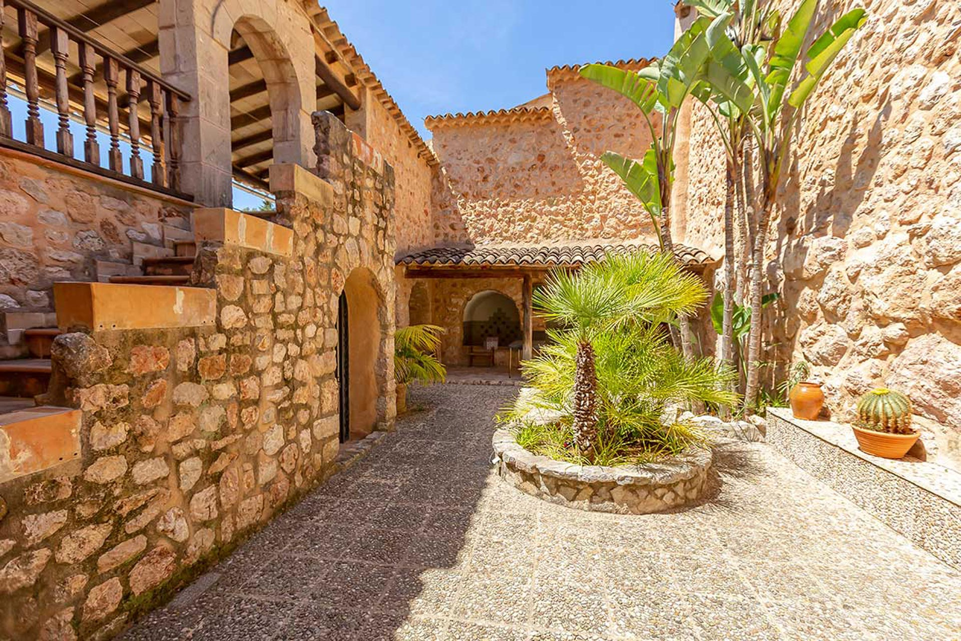 Interior traditional patio of this large stone house in Fornalutx